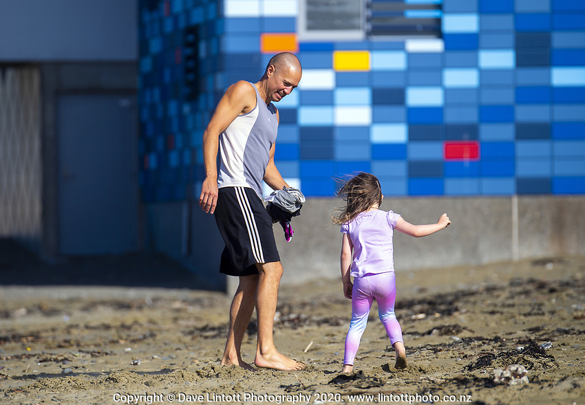 Tane Morgan and his daughter Mila play on Lyall Bay beach on Easter Monday during lockdown for the COVID19 pandemic in Wellington, New Zealand on Monday, 13 April 2020. Photo: Dave Lintott / lintottphoto.co.nz