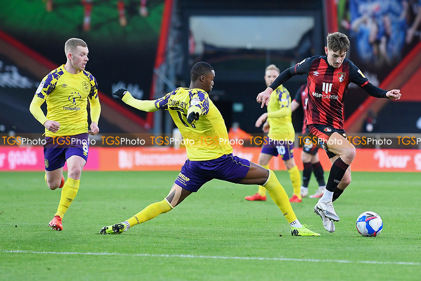 David Brooks of AFC Bournemouth right avoids the tackle from Adama Diakhaby of Huddersfield Town during AFC Bournemouth vs Huddersfield Town, Sky Bet EFL Championship Football at the Vitality Stadium on 12th December 2020