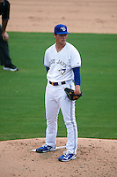 Dunedin Blue Jays pitcher Sean Reid-Foley (4) looks in for the sign during the first game of a doubleheader against the Palm Beach Cardinals on August 2, 2015 at Florida Auto Exchange Stadium in Dunedin, Florida.  Palm Beach defeated Dunedin 4-1.  (Mike Janes/Four Seam Images)