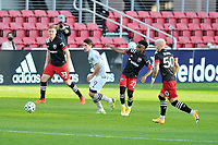 WASHINGTON, DC - NOVEMBER 8: Bojan #9 of Montreal Impact battles for the ball with Moses Nyeman #27 of D.C. United during a game between Montreal Impact and D.C. United at Audi Field on November 8, 2020 in Washington, DC.