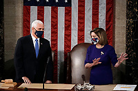 Speaker of the House Nancy Pelosi, D-Calif., and Vice President Mike Pence talk before a joint session of the House and Senate convenes to count the Electoral College votes cast in November's election, at the Capitol in Washington, Wednesday, Jan. 6, 2021. <br /> CAP/MPI/RS<br /> ©RS/MPI/Capital Pictures