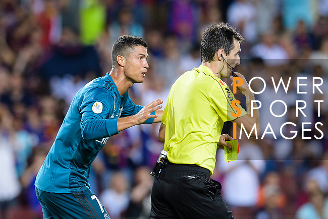 Cristiano Ronaldo of Real Madrid (L) gets a red card from Fifa Referee Ricardo de Burgos Bergoetxea (R) during the Supercopa de Espana Final 1st Leg match between FC Barcelona and Real Madrid at Camp Nou on August 13, 2017 in Barcelona, Spain. Photo by Marcio Rodrigo Machado / Power Sport Images