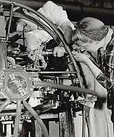 Revolutionary! exclaimed a supervisor; at women working on parts of fuselage; as Valida igle and Jean Neil are; rivetting main piping<br /> <br /> PHOTO :    - Toronto Star Archives - AQP