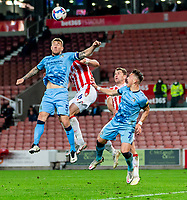 21st April 2021; Bet365 Stadium, Stoke, Staffordshire, England; English Football League Championship Football, Stoke City versus Coventry; Kyle McFadzean of Coventry City heads the ball clear