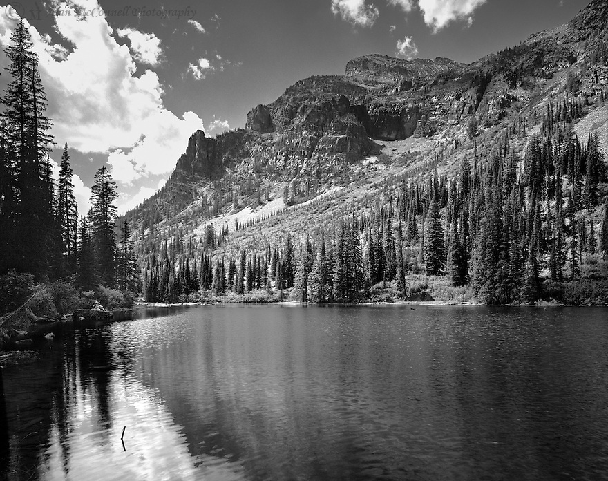 """""""An Intimate Moment at Lake Snyder""""<br /> Glacier National Park<br /> <br /> A young couple enjoy the solitude of the back country as they sit on a rock next to Lake Snyder."""