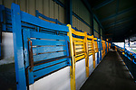 Yellow and blue seats in the Jamie Vardy Stand at Look Local Stadium. The seats were originally used at Hillsborough. Stocksbridge Park Steels v Pickering Town,  Evo-Stik East Division, 17th November 2018. Stocksbridge Park Steels were born from the works team of the local British Steel plant that dominates the town north of Sheffield.<br /> Having missed out on promotion via the play offs in the previous season, Stocksbridge were hovering above the relegation zone in Northern Premier League Division One East, as they lost 0-2 to Pickering Town. Stocksbridge finished the season in 13th place.