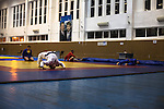 Ethnic Russian wrestlers, who moved to Grozny after promises of great sport perspectives by republic's leader Ramzan Kadyrov, train in a sport facility in downtown Grozny. Grozny, Chechnya, Russia, 2012