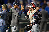 Cleveland Indians catcher Roberto Perez Perez (55) celebrates with Erik Gonzalez (left) and Chris Gimenez after closing out Game 4 of the Major League Baseball World Series against the Chicago Cubs on October 29, 2016 at Wrigley Field in Chicago, Illinois.  (Mike Janes/Four Seam Images)