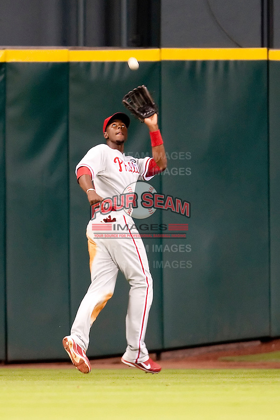 Philadelphia Phillies outfielder John Mayberry Jr #15 makes a catch during the Major League Baseball game against the Houston Astros at Minute Maid Park in Houston, Texas on September 13, 2011. Houston defeated Philadelphia 5-2.  (Andrew Woolley/Four Seam Images)