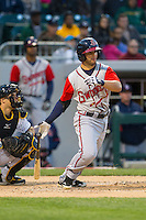 Tommy La Stella (11) of the Gwinnett Braves follows through on his swing against the Charlotte Knights at BB&T Ballpark on April 16, 2014 in Charlotte, North Carolina.  The Braves defeated the Knights 7-2.  (Brian Westerholt/Four Seam Images)