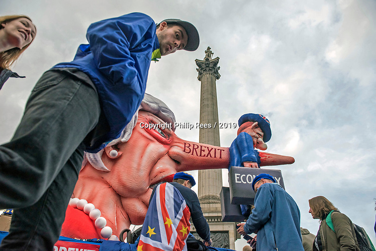 "An effigy of Prime Minister Theresa May underneath Nelsons Column on the edge of Trafalgar Square today during the ""Put it to the People"" rally which made it's way through central London today. Demonstrators from across the country gathered to call for a second referendum on Brexit and to march through the UK capital finishing with speeches in Parliament Square opposite the Houses of Parliament in Westminster."