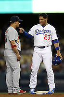 Rafael Furcal #15 of the St.Louis Cardinals talks with Bobby Abreu #23 of the Los Angeles Dodgers during a game at Dodger Stadium on May 18, 2012 in Los Angeles,California. Los Angeles defeated St.Louis 6-5.(Larry Goren/Four Seam Images)