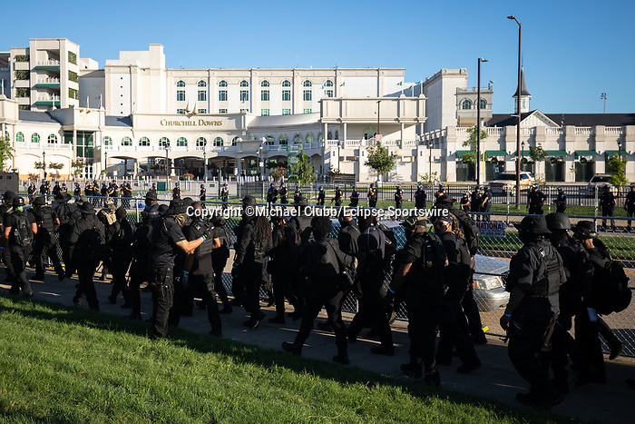 """September 5, 2020:  Members of the NFAC are met with police presence outside of Churchill Downs  the 146th Kentucky Derby. With the Kentucky Derby being the biggest sports event for the State of Kentucky, protestors have chosen the  event as a focal point for their calls for justice in the death of Breonna Taylor. Multiple groups from around the country have converged on Louisville to protest during the """"Run for the Roses"""" at Churchill Downs in Louisville. Michael Clubb/Eclipse Sportswire/CSM"""