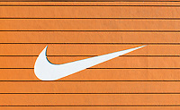 The iconic Nike swoosh logo.