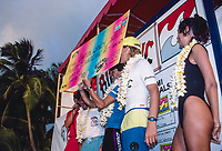 Barton Lynch (AUS) receives the winners check from Billabongs founder Gordon Merchant (AUS) after winning the 1988 Billabong Pro in Hawaii. Luke Egan was runner up in the event which was mobile around the North Shore. The final day was run a Pipeline. Photo: joliphotos.com