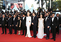 Okja' Red Carpet Arrivals - The 70th Annual Cannes Film Festival<br /> CANNES, FRANCE - MAY 19: (R-L) Actors Giancarlo Esposito, Byung Heebong, Steven Yeun, director Bong Joon-Ho, actors Tilda Swinton, Paul Dano, Lily Collins, Jake Gyllenhaal and Devon Bostic attend the 'Okja' screening during the 70th annual Cannes Film Festival at Palais des Festivals on May 19, 2017 in Cannes, France