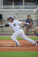 GCL Yankees East catcher Carlos Gallardo (16) follows through on a swing during the first game of a doubleheader against the GCL Blue Jays on July 24, 2017 at the Yankees Minor League Complex in Tampa, Florida.  GCL Blue Jays defeated the GCL Yankees East 6-3 in a game that originally started on July 8th.  (Mike Janes/Four Seam Images)
