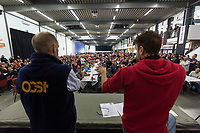 Switzerland. Canton Ticino. Bellinzona. The wave of national protest in the construction industry began on October 15 in Ticino. 3000 masons from Ticino interrupted their work to meet in Bellinzona and demand that retirement be maintained at 60. In addition to retirement at 60, the fight against wage dumping and longer working hours are at the heart of the demands. Unia and OCST unions said in a joint statement that masons have had enough after a year of blocking negotiations and blackmail. On stage, Paolo Locatelli (L) from OCST and Dario Cadenazzi (R) from Unia. The workers and their unions have therefore decided to start a national protest. If no agreements are found between workers and constructions companies, a strike might occur in the near future. 15.10.2018 © 2018 Didier Ruef