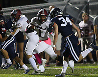 Davon Sparks (1) of Springdale sparks runs the ball as Ross Haney (34) of Springdale Har-ber looks to make tackle on Friday, Oct. 8, 2021, during the first half of play at Wildcat Stadium in Springdale. Visit nwaonline.com/211009Daily/ for today's photo gallery.<br /> (Special to the NWA Democrat-Gazette/David Beach)