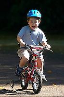 Josh riding small Raleigh bike  ..Virginia Water , Surrey , Sept 2003..