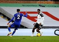 3rd February 2021; Craven Cottage, London, England; English Premier League Football, Fulham versus Leicester City; Ola Aina  of Fulham being marked by James Justin of Leicester City