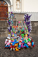 Antigua, Guatemala.  Vendor's Stand of Toys, Balloons, Cucurucho Dolls.  Semana Santa.