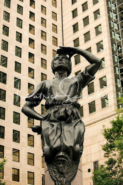 The city of Charlotte has four statues on the corners of the main square of the city, the corners of Trade Street and Tryon Street. This figure, of a mill worker wearing a bonnet, represents Industry. The three other statues represent Transportation, Future and Commerce. American sculptor Raymond Kaskey created the four public art statues. Some people say the child peeking out from beneath her skirt represents child labor in the past.