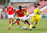 10th October 2020; The County Ground, Swindon, Wiltshire, England; English Football League One; Swindon Town versus AFC Wimbledon; Diallang Jaiyesimi of Swindon Town being challenged by Jaakko Oksanen and Steve Seddon of AFC Wimbledon