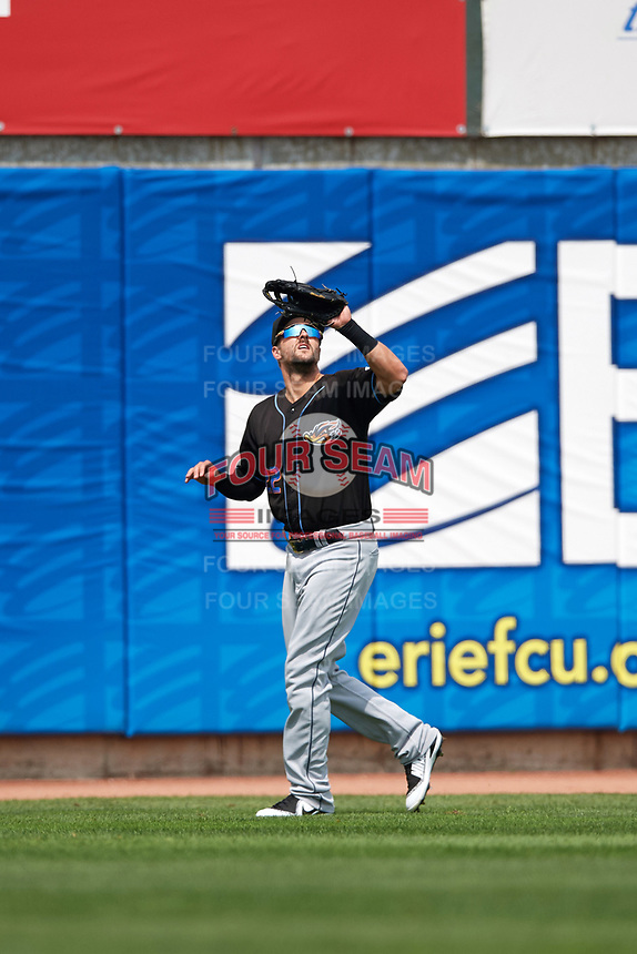 Cleveland Indians Lonnie Chisenhall (22), on rehab assignment with the Akron RubberDucks due to a right calf injury, catches a fly ball during a game against the Erie SeaWolves on August 27, 2017 at UPMC Park in Erie, Pennsylvania.  Akron defeated Erie 6-4.  (Mike Janes/Four Seam Images)