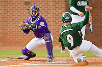Brad Elwood (9) of the Charlotte 49ers slides into home plate as catcher Spencer Angelis (11) of the High Point Panthers waits to apply the tag at Willard Stadium on February 20, 2013 in High Point, North Carolina.  The 49ers defeated the Panthers 12-3.  (Brian Westerholt/Four Seam Images)