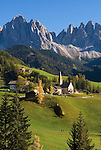 Italy, South Tyrol, Alto Adige, Dolomites, Val di Funes: mountain village St. Magdalena and Le Odle mountains at natural park Puez-Odle