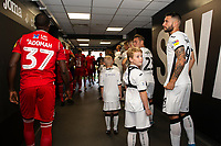 Borja Baston of Swansea City with mascot during the Sky Bet Championship match between Swansea City and Nottingham Forest at the Liberty Stadium in Swansea, Wales, UK. Saturday 14 September 2019