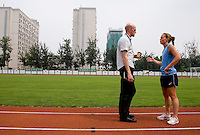 USWNT captain Christie Rampone talks to Grant Wahl of Sports Illustrated following practice at Beijing Normal University in preparation for the Olympic gold medal game at Workers' Stadium in Beijing, China.