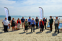 BNPS.co.uk (01202 558833)<br /> Pic: Graham Hunt/BNPS<br /> <br /> Councillors pose for a photo at the end of the meeting.<br /> <br /> Town hall officials swapped their stuffy chambers for the sand and sea today as they took part in what is thought to be the UK's first ever council meeting on a beach.<br /> <br /> Weymouth Town Council in Dorset held the event on the beach in protest at the Government banning virtual meetings.<br /> <br /> Since May 6, votes cast at virtual council meetings have not been legally binding following a controversial ruling upheld by a High Court judge.<br /> <br /> But because social distancing is difficult to practice in many town halls, officials in Weymouth used a loophole in the rules to meet on a beach.