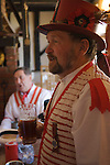Morris men singing traditional english folk song in village pub. Thaxted Essex England 2006