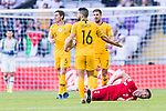 Aziz Behich of Australia (C) reacts as Yousef Rawshdeh of Jordan (R) lies injured on the pitch during the AFC Asian Cup UAE 2019 Group B match between Australia (AUS) and Jordan (JOR) at Hazza Bin Zayed Stadium on 06 January 2019 in Al Ain, United Arab Emirates. Photo by Marcio Rodrigo Machado / Power Sport Images