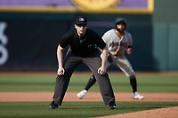 Umpire Mitch Leikam handles the calls on the bases during the game between the Hickory Crawdads and the Winston-Salem Dash at Truist Stadium on July 10, 2021 in Winston-Salem, North Carolina. (Brian Westerholt/Four Seam Images)