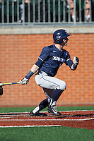 Will LaRue (10) of the Xavier Musketeers follows through on his swing against the Charlotte 49ers at Hayes Stadium on March 3, 2017 in Charlotte, North Carolina.  The 49ers defeated the Musketeers 2-1.  (Brian Westerholt/Four Seam Images)