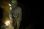 A driller pausing for rest in La Negra mine.