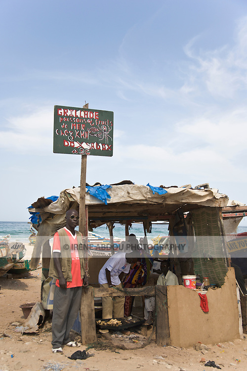 """A beachside """"restaurant"""" serves fresh grilled fish in Yoff, a fishing village 30 minutes from Senegal's capital city of Dakar."""