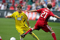 Columbus Crew midfielder Robbie Rogers (19) gets by Chicago Fire midfielder Justin Mapp (21).  The Columbus Crew tied the Chicago Fire 2-2 at Toyota Park in Bridgeview, IL on September 20, 2009.