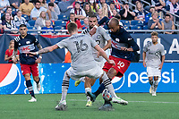FOXBOROUGH, MA - JULY 25: Joel Waterman #16 of CF Montreal tackles Teal Bunbury #10 of New England Revolution near the CF Montreal goal during a game between CF Montreal and New England Revolution at Gillette Stadium on July 25, 2021 in Foxborough, Massachusetts.