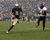 Pittsburgh quarterback Bill Stull scores on a 3-yard touchdown run. The Cincinnati Bearcats defeated the Pittsburgh Panthers 45-44 in the final seconds of the River City Rivalry in a contest for the Big East Championship and a major bowl bid on December 5, 2009 at Heinz Field, Pittsburgh, Pennsylvania. .
