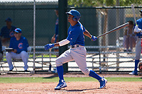Chicago Cubs outfielder Roberto Caro (13) follows through on his swing during an Extended Spring Training game against the Los Angeles Angels at Sloan Park on April 14, 2018 in Mesa, Arizona. (Zachary Lucy/Four Seam Images)