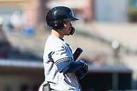 Peoria Javelinas second baseman Keston Hiura (23), of the Milwaukee Brewers organization, on deck during an Arizona Fall League game against the Surprise Saguaros at Surprise Stadium on October 17, 2018 in Surprise, Arizona. (Zachary Lucy/Four Seam Images)