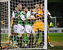 IT ALL KICKS OFF IN THE GOAL MOUTH AFTER HIBERNIAN'S IVAN SPROULE TRIES TO RETRIEVE THE BALL AFTER SCORING