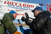 Mats Pettersson is interviewed at the finish line in Nome on Thursday March 19, 2015 during Iditarod 2015.  <br /> <br /> (C) Jeff Schultz/SchultzPhoto.com - ALL RIGHTS RESERVED<br />  DUPLICATION  PROHIBITED  WITHOUT  PERMISSION