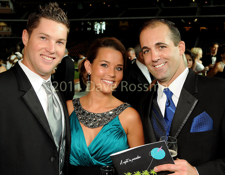 From left: Bud Norris, Aubree Gerardi and Tim Byrdak at the annual Astros Wives Gala at Minute Maid Park Thursday Aug. 12,2010.(Dave Rossman/For the Chronicle)