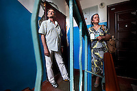 Fatima Davdieva and her husband Oumar Chagaev at the door of their old apartment. This is the only building in the district not to have been bombed. Together with their three children, Fatima and Oumar fled Grozny ten years ago during the Second Chechen War as refugees. Now as Belgian nationals they return for the first time to visit their friends, family and former home.