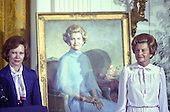 """First lady Rosalynn Carter, left, and former first lady Betty Ford pose next to the portrait of Mrs. Ford that was unveiled during a ceremony in the East Room of the White House in Washington, DC on August 4, 1980. The painting will be on permanent display at the White House along with those of other US Presidents and first ladys.  <br /> Credit: Benjamin E. """"Gene"""" Forte / CNP"""